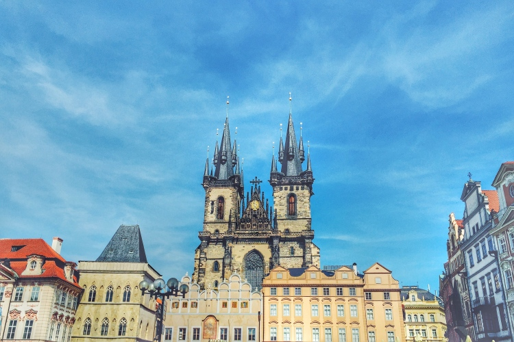 View of Church of Our Lady before Týn from the Old Town Square. The most famous church that dominates the view of the Old Town Square is blessed with a Gothic architectural style piercing onto the Czech sky.