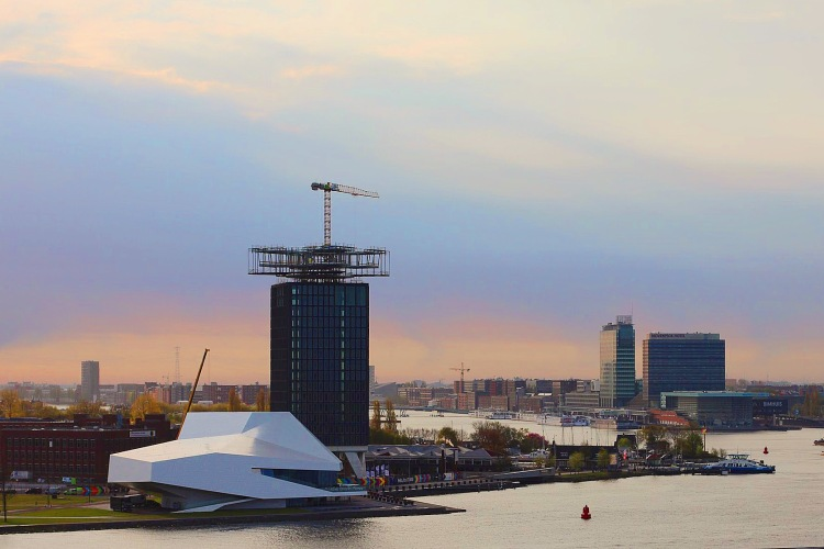 Sunset over the modern part of Amsterdam. The tall building soon will be the 360 degree rotating restaurant.