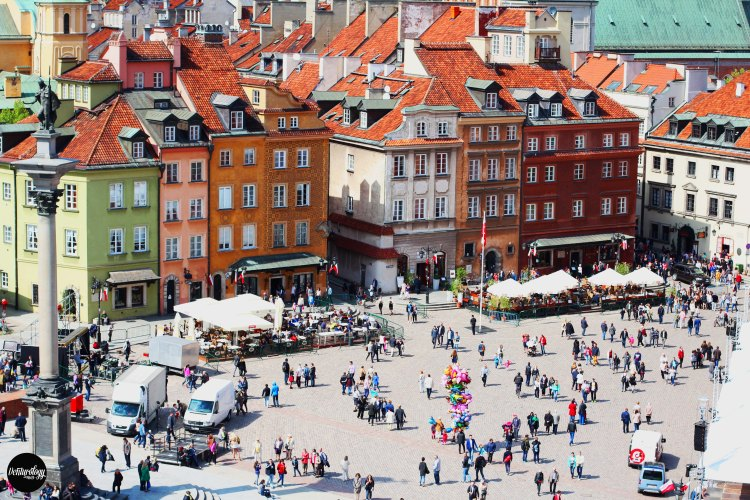 The Old Town of Warsaw and its miniature citizen.